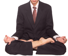 Image of man in suit in lotus position